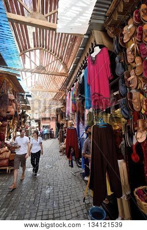 MARRAKESH - AUGUST 08: Unknown people in a market (souk) August 08 2015 in a Marrakesh Morocco. The traditional Berber market is one of the most important attractions of the city Marrakesh Morocco