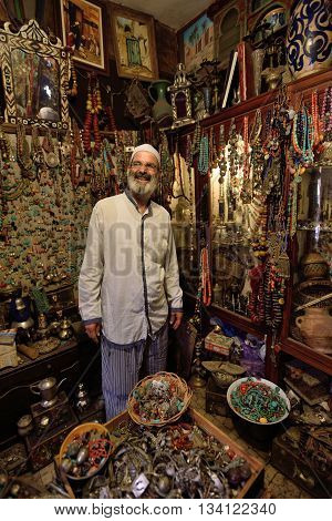 MARRAKESH - AUGUST 08: Unknown man in a market (souk) August 08 2015 in a Marrakesh Morocco. The traditional Berber market is one of the most important attractions of the city Marrakesh Morocco