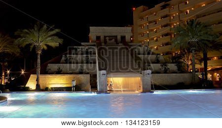 LAS VEGAS, NEVADA, MAY 23. The Cancun Resort on May 23, 2016, in Las Vegas, Nevada. A group of late night bathers enjoys the Mayan waterscape and dramatic lighting effects at the Cancun Resort in Las Vegas Nevada.