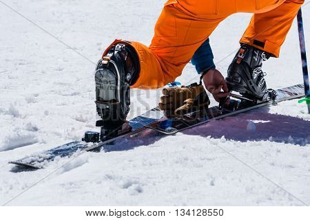 Adjust Skiing equipment and extreme winter sports at place for skiing Snowshoes and ski equipment