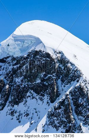 Peak of the snowy mountain from Alps Swiss Alpine Alps mountain landscape and place for skiing at Matterhorn Switzerland