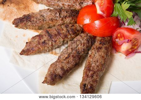Grilled kebab meat with pomegranate and sauce