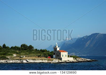 Seascape and lighthouse on the coast near Hvar island, Croatia