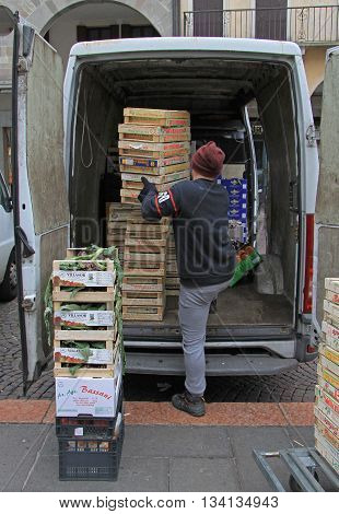 Man Is Unloading Boxes With Fruits In Padua, Italy