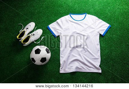 Soccer Ball,cleats And White T-shirt Against Artificial Turf