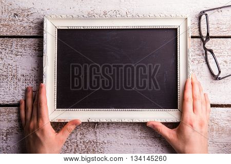 Unrecognizable Woman Holding Empty Picture Frame, Eyeglasses. St