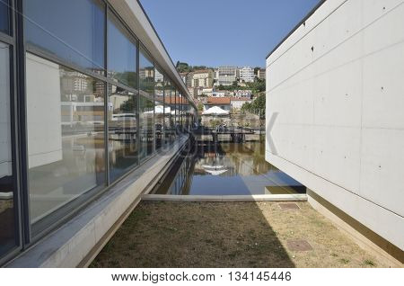 COIMBRA, PORTUGAL - AUGUST 4, 2016: Terrace Bar next to a pond in the Saint clare the Older Interpretative Centre designed by the architects Alexandre Alves and Sergio Fernandez in the city of Coimbra in Portugal.
