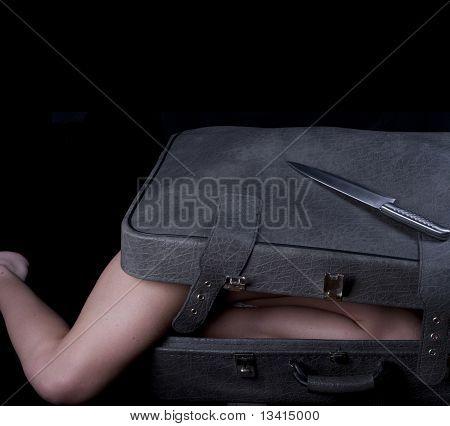 Dead blonde body in suitcase