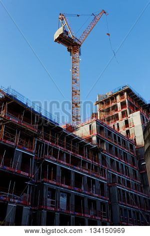 NELSON STREET, BRISTOL, ENGLAND, 22 JANUARY 2016. Watkin Jones Liebherr Tower Crane Assembling New Building with Safety Fencing, part of a huge redevelopment of Bristol City Centre
