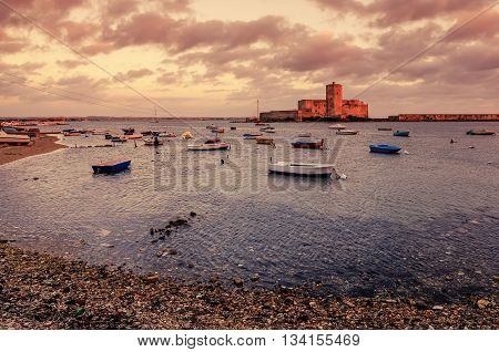 Sicily, Italy: fishermen's harbor in Trapani in the sunset