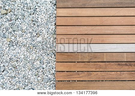 Wood deck floor over the stone sand beach background