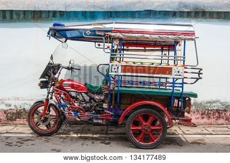 Loei, Thailand-March 26: The classical auto rickshaw is the unique vehicle style of local transportation in any province of Thailand on March 26, 2015 in Loei, Thailand.