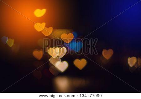 Multicolour bokeh Heart shape defocused bokeh lights as background