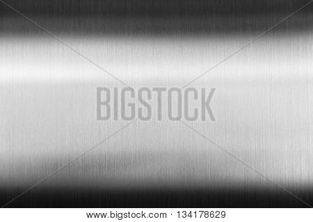 Shiny metal platethe shiny metal plate reflection with the shadow.The clean metal plate in black and white scene.The polishing metal plate shiny with the shadow.Shiny metal plate by brushing process.