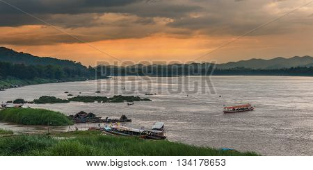 Chiang Khan, Loei, Thailand - March 26, 2015: Riverside view of Khong river, the natural border between Thailand and Laos in Chiang Khan, Loei, Thailand
