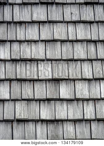 wooden shingles on the roof as a background