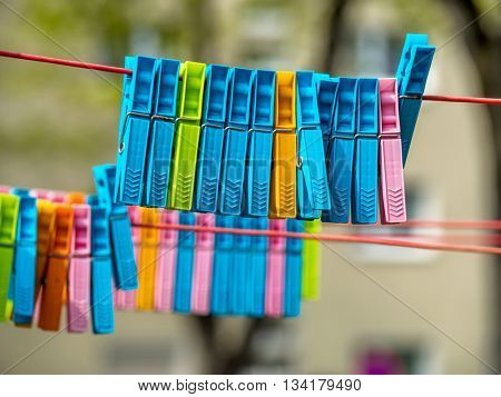 colorful clothespins on clothesline