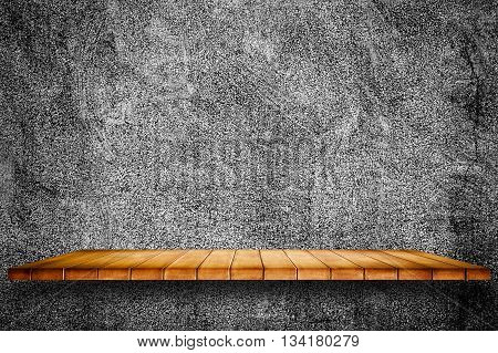 Empty wooden shelf on grunge cement wall background. For display or montage your products.