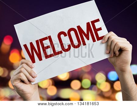 Welcome placard with night lights on background