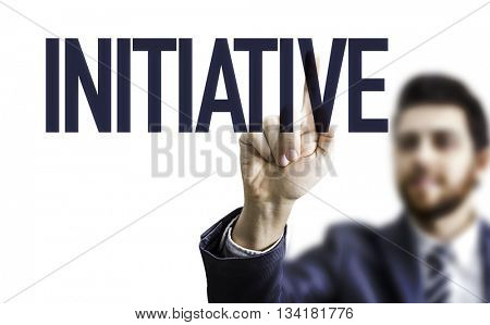 Business man pointing the word: Initiative