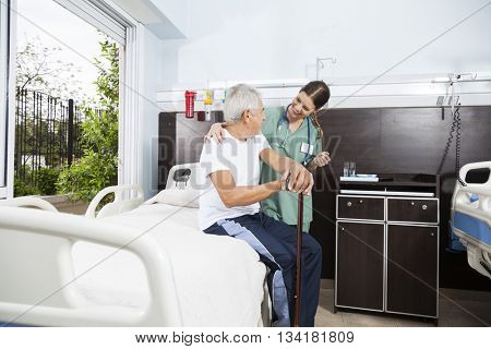 Senior Patient And Nurse Looking At Each Other