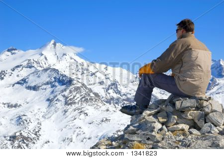 Man Overlooking The Mountains