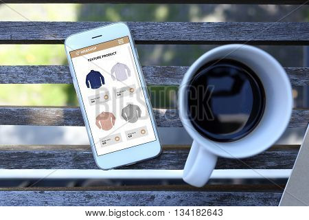 Smartphone with ecommerce website screen and coffee cup