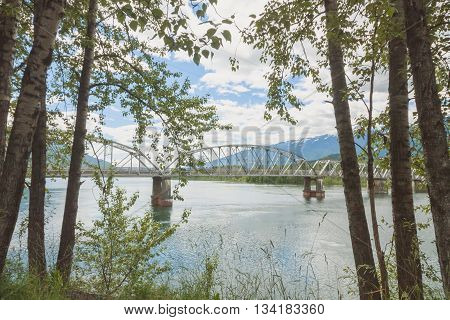 Landscape of tree framed Big Eddy Bridge in Revelstoke British Columbia