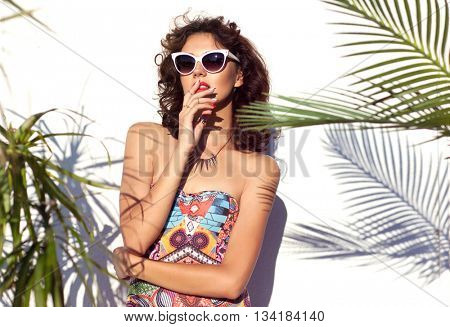 Summer style portrait of young attractive woman wearing sunglasses. Tropical summer fashion beauty  concept