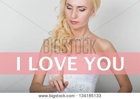 technology, internet and networking concept. Beautiful bride in fashion wedding dress. Bride presses i love you button on virtual screens.