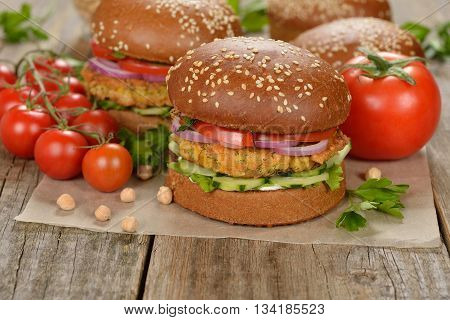 Vegetarian burger on a wooden background close up