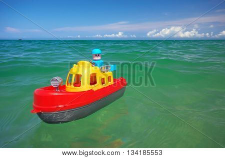 Toy ship boat and sea wave. Conceptual design.