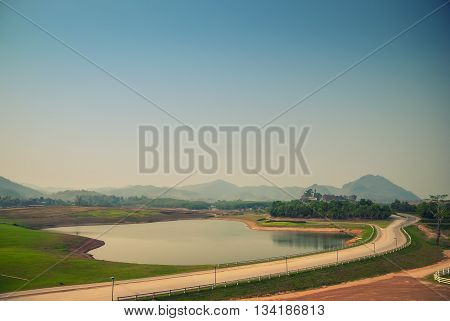 a big reservoir with surrounding by mountain and blue sky
