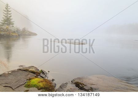 lake with rocks in water and moss