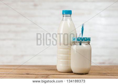Milk bottle on wooden table