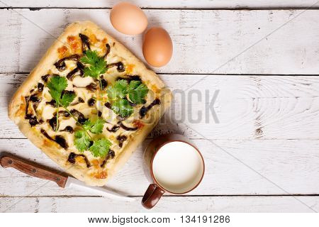 Quiche with mushrooms and cheese. French pie on a table. Top view
