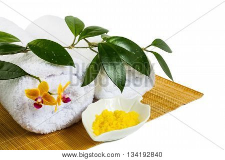 Spa concept with yellow cosmetic salt isolated on white. Wellness concept. Spa still life concept