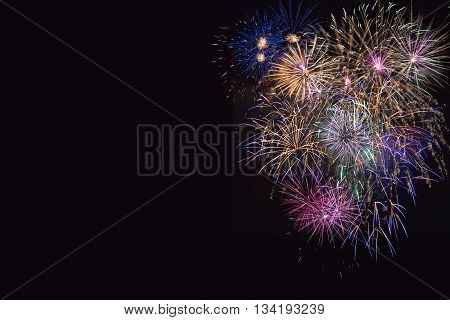 Beautiful celebration lilac purple and golden fireworks. 4th of July beautiful fireworks. Independence Day New Year holidays salute copy space.