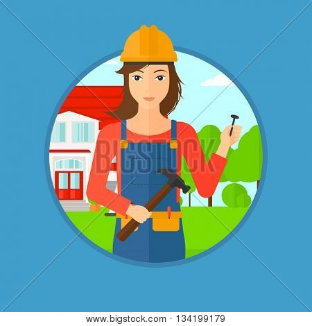 A female builder in uniform and helmet. A builder with hummer and nail in hands. Builder on a background of house. Vector flat design illustration in the circle isolated on background.