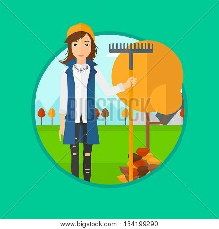 A woman raking autumn leaves. Woman with rake standing near tree and heap of autumn leaves. Woman tidying autumn leaves in garden. Vector flat design illustration in the circle isolated on background.