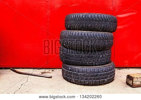 Car tyre shop background with some old used tires.