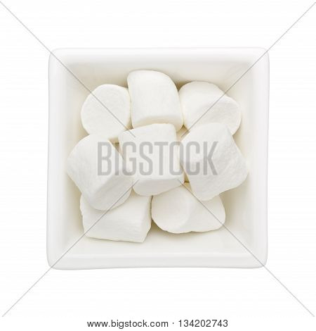 Marshmellows in a square bowl isolated on white background