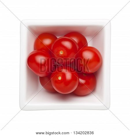 Cherry tomatoes in a square bowl isolated on white background