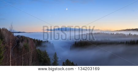 evening forest mountain landscape with mist and moon and railroad