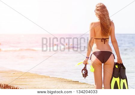Young Slim Woman With Snorkelling Stuff At The Sea