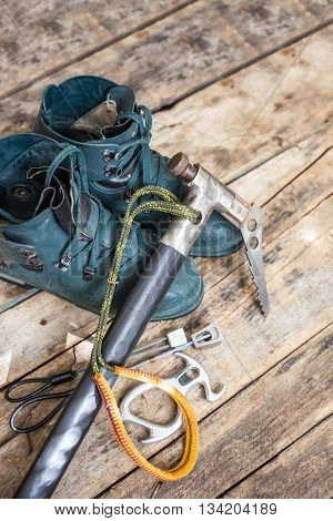 Handmade Ice Axe With Old Boots On Wood Background