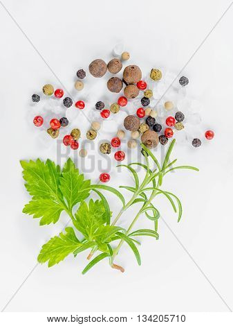Flat Lay Of Different Peppers, Greenery And Sea Salt On White Background, Close Up
