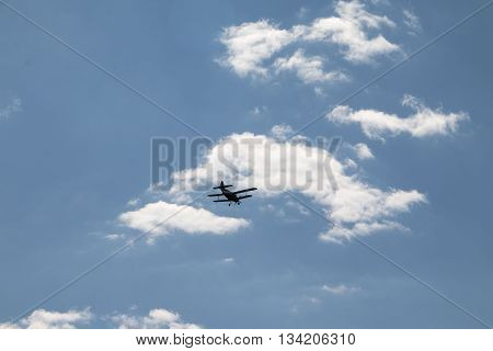 Small Old Airplane In Blue Sky In A Day