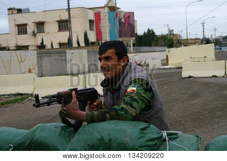 KIRKUK, IRAQ-JANUARY 21:Kurdish soldier stands guard on a check point in front of Kurdistan Democratic Party Building on January 21, 2007 in Kirkuk, Iraq.