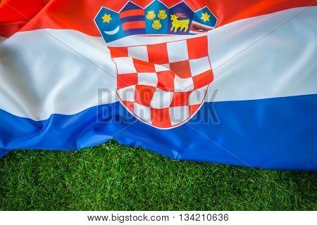 Flags of Croatia on green grass